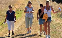 Small group of women walking downhill
