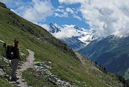Walker on a trail in the Swiss Alps