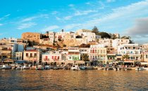 Greek seafront village seen from the sea.