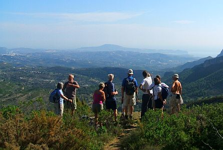group of walkers looking out from a viewpoint in spain