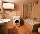 Bathroom with a bathtub, sink and a washing machine