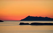 Shadow of islands in the sea on the golden light of a sunset
