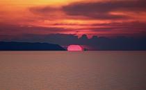 Sunset behind a sea