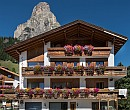 Beautiful chalet in the Italian Dolomites with many flowers on the terrace