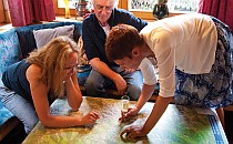 People looking at a table top map