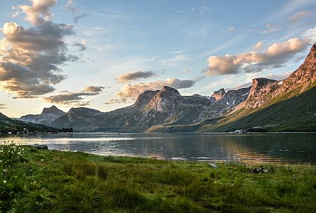 lake with steep rocky mountains in norway