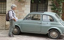 Lady looking at an old car