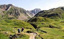 Guide with walkers on a track high in the Pyrenees in France