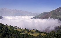 Overview to a valley with low clouds