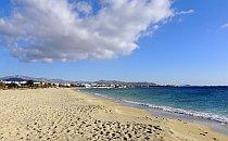 Empty sandy beach under a blue sky