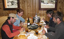 sharing a meal in a mountain hut
