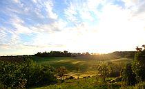 sunset over rural landscape in France