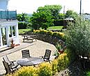 Exterior and gardens of walking holiday accommodation in Cornwall