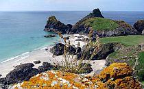 Beautiful rugged and Rocky Cornish coastline with a sandy beach.
