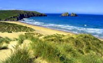 Sandy dunes and wide beach in Cornwall