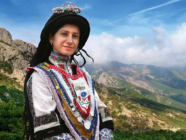 Young woman wearing traditional costume from the pindus region