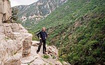 Walker on a rock path along a mountain ridge