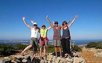 Group of 4 hikers waving