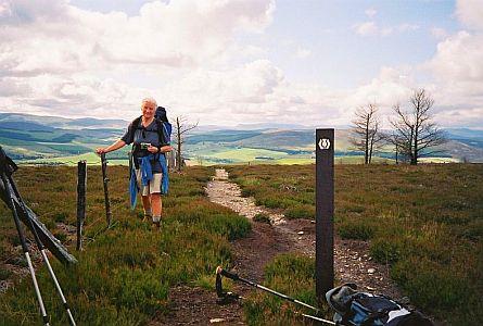 walker resting along a walking trail in scotland