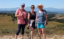 Three walkers posing for a photo during their walking holiday in France