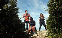 3 hikers climbed a rocky top