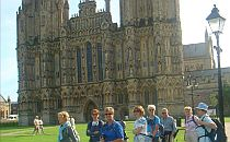 group of people in front of a cathedral