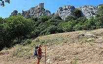 Woman walking along cliffs in France