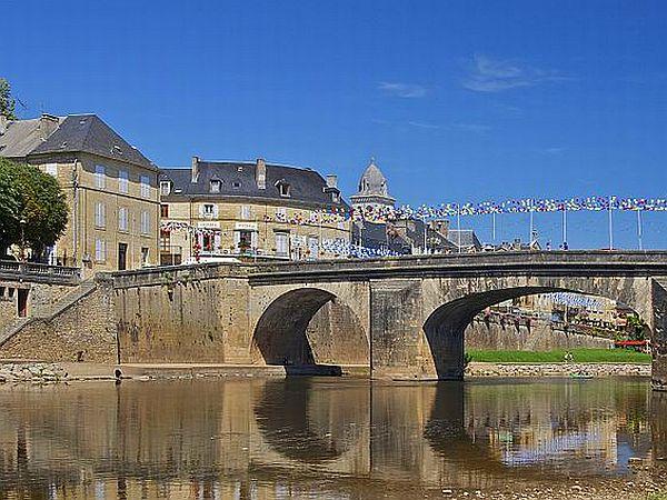 Stone bridge in riverside town in the Dordogne