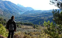 Walker looking at guadest valley in Alicante