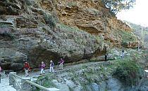 people walking through a canyon