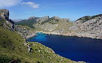 Mountain lake with beautiful hills around