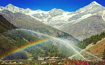 Mountain hut under a rainbow