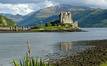 A castle in the middle of a lake in the Highlands in Scotland