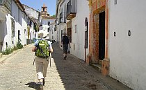 Hiking through a cobled street with whitewashed houses