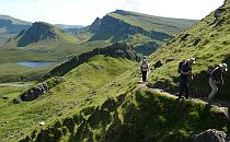 People walking on a trail into the Quiraing, Skye