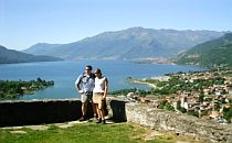 Two walkers in front of Lake Como in North Italy.