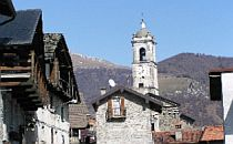 Historic houses and church in a village at Lake Como.
