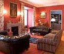 Living room with comfortable leather sofas in the 18th century residence of the Earl of Tepa