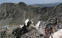 Hikers on a rocky slope