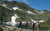 Hikers eploring lake in pirin mountain