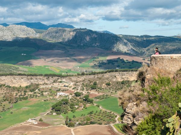 People looking out over countryside around the city of Ronda