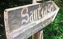 Wooden waymarker indicating the route to Santiago de Compostela