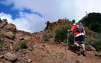 Man walking uphill on a trail