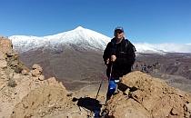 Man posing in front of snowy peak