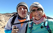 A man and a woman in hiking gear