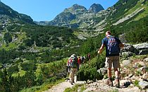 Hikers on a rocky path in Rila