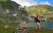 Hiker by the lake in Rila mountain