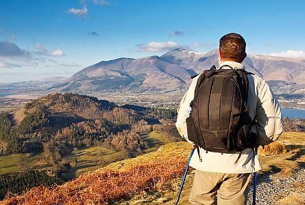person on a self-guided walking holiday overlooking a landscape