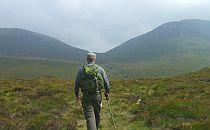 Hiker walking a trail in Ireland