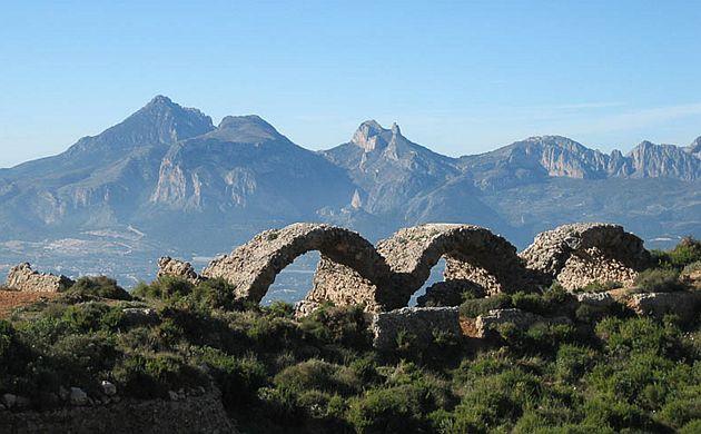 Stone bridges, rocky peak behind them